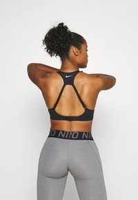 Nike Performance - ALPHA BRA - High support sports bra - black/white - 2