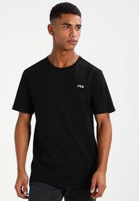 Fila - UNWIND TEE - Camiseta básica - black - 0
