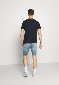 Levi's® - 511™ SLIM HEMMED SHORT - Denim shorts - med indigo - worn in - 2