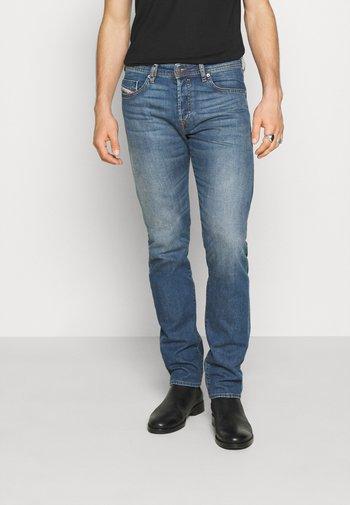 BUSTER-X - Straight leg jeans - blue denim