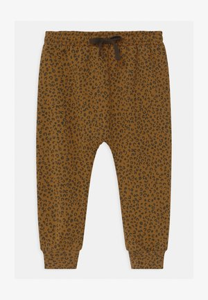 KARL UNISEX - Trousers - golden brown
