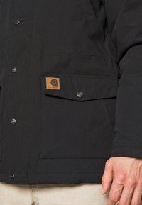 Carhartt WIP - TRAPPER  - Winter coat - black - 6
