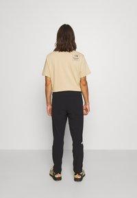 The North Face - TECH PANT - Pantalon de survêtement - black - 3