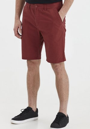 TITIAN - Shorts - brick red