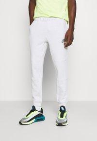 Nike Sportswear - Pantalon de survêtement - pure - 0