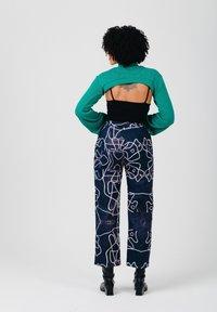 Solai - Trousers - black & white - 2