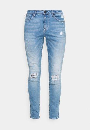 HARRY - Slim fit jeans - washed blue denim