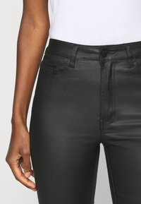 Object Tall - OBJBELLE COATED - Bootcut jeans - black - 5