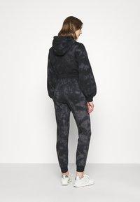Ellesse - LORIOR - Tracksuit bottoms - dark grey - 2