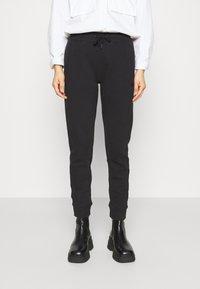 Calvin Klein Jeans - GLITTER MONOGRAM  - Tracksuit bottoms - black - 0