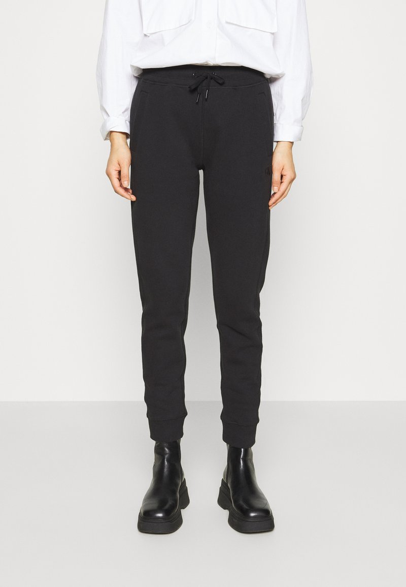Calvin Klein Jeans - GLITTER MONOGRAM  - Tracksuit bottoms - black