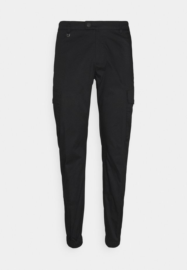 TROUSERS NIKKI SKINNY FIT IN STRETCH - Cargo trousers - nero