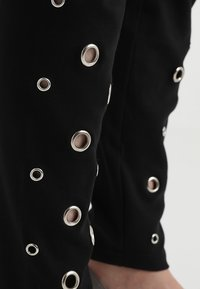 Urban Classics Curvy - LADIES EYELET - Leggings - Trousers - black - 6