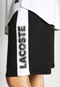 Lacoste - Tracksuit bottoms - noir/blanc - 4