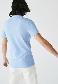 Lacoste - Polo shirt - bleu - 1
