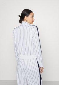 Fila - HALA TRACK JACKET - Summer jacket - blanc de blanc/black iris - 2