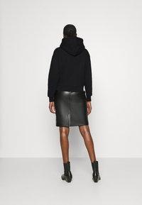 Calvin Klein Jeans - ECO HOODIE - Hoodie - black - 2