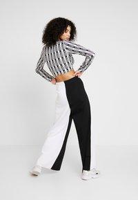 adidas Originals - PANT - Träningsbyxor - black/white - 2