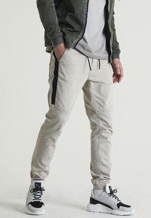 RESA.L MADRID - Trousers - beige