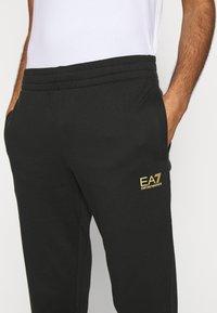 EA7 Emporio Armani - PANTALONI - Tracksuit bottoms - black - 5