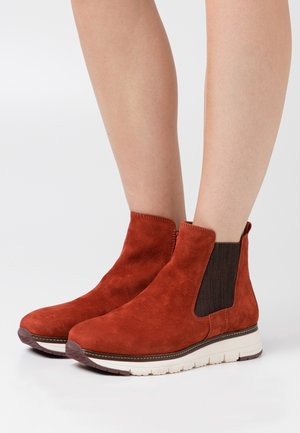 RELAXED FIT - Classic ankle boots - burned orange