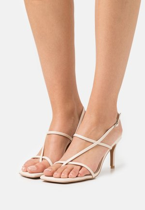 STRAPPY  - T-bar sandals - beige