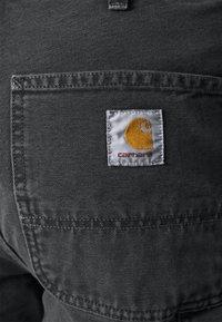 Carhartt WIP - DEARBORN SINGLE KNEE PANT - Kalhoty - black worn - 4