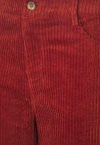 ICHI - IHJORELLE - Trousers - burnt henna - 2