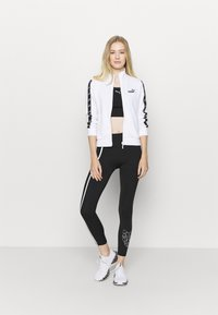 Puma - TRAIN - Leggings - black/white - 1