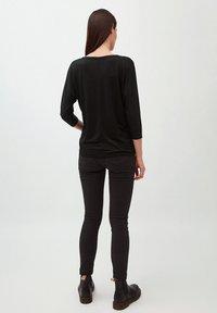 ARMEDANGELS - Long sleeved top - black - 2