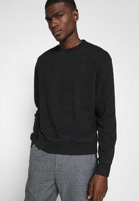 Jack & Jones - JORELLIOT  - Sweatshirt - black - 5