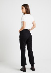 G-Star - CODAM HIGH KICK 7/8 - Flared jeans - black - 2