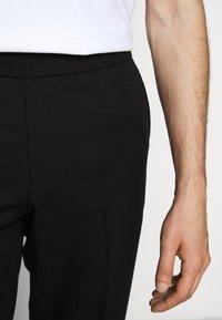Filippa K - TERRY CROPPED SLACKS - Trousers - black - 4