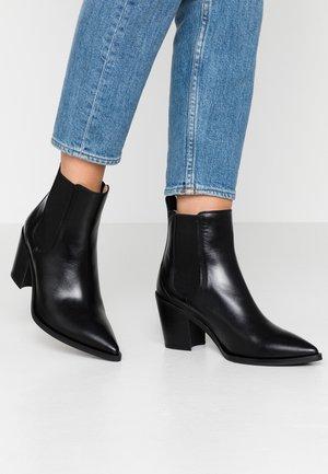 MANILA - Ankle boots - black