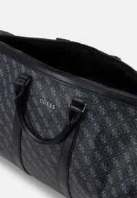 Guess - VEZZOLA UNISEX - Weekend bag - black - 2