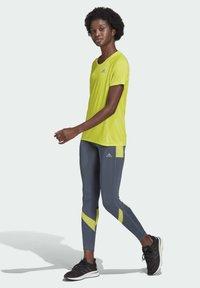 adidas Performance - ADI RUNNER PRIMEGREEN RUNNING - T-shirts - yellow - 1