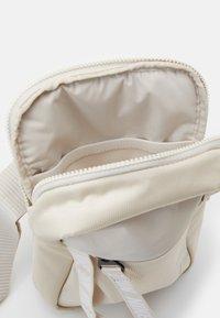 Nike Sportswear - ESSENTIALS UNISEX - Across body bag - white - 2