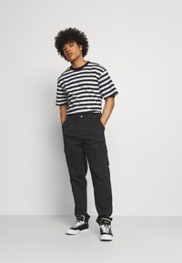 The North Face - PANT - Cargo trousers - black - 1