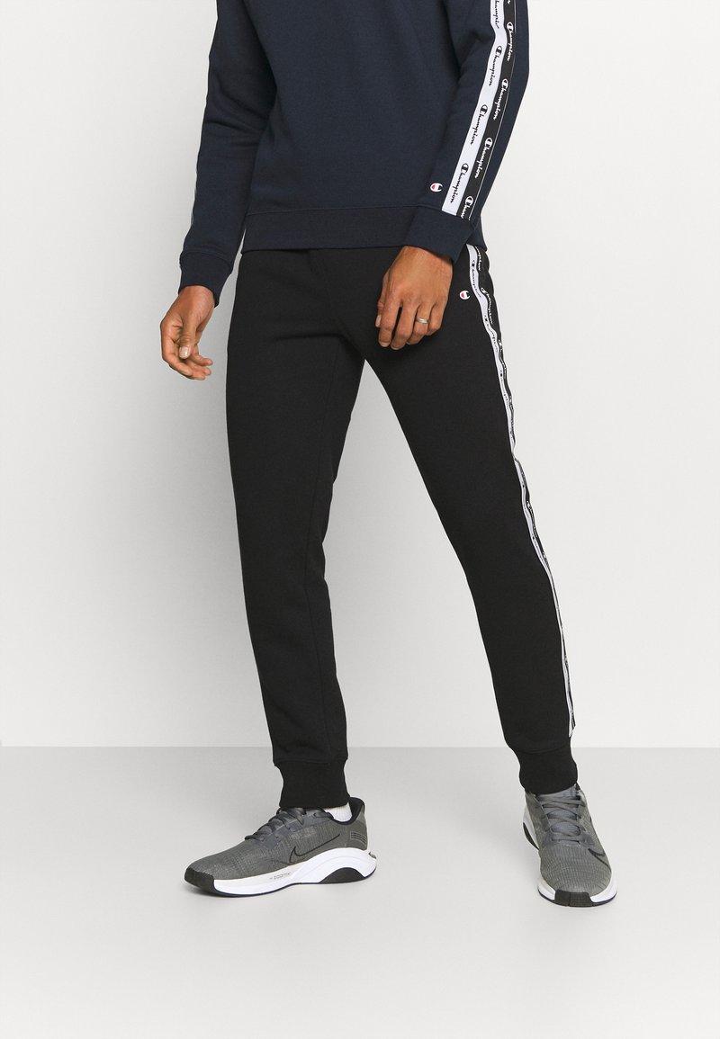 Champion - CUFF PANTS - Träningsbyxor - black