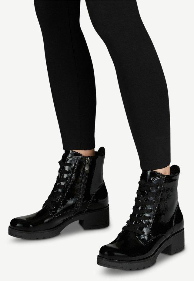 STIEFELETTE - Platform ankle boots - black patent