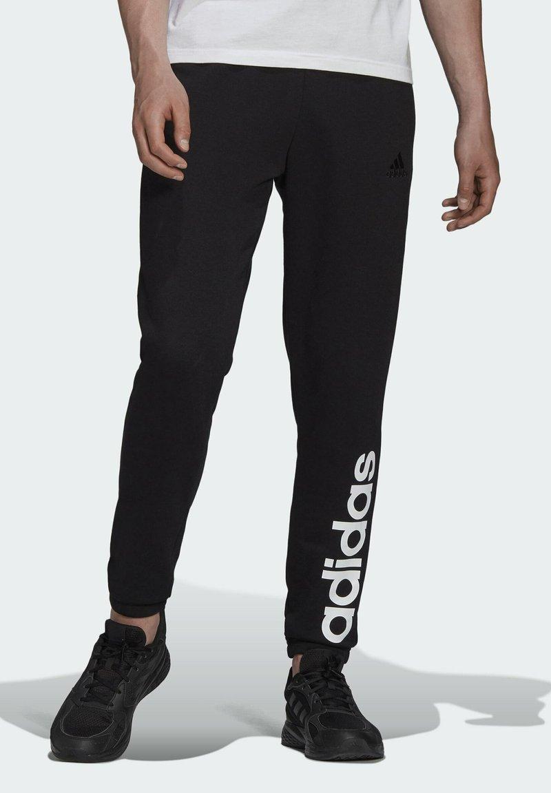 adidas Performance - Tracksuit bottoms - black