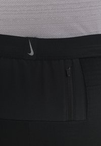 Nike Performance - PANT TRAIL - Verryttelyhousut - black/laser crimson - 6