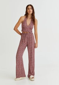 PULL&BEAR - MIT PRINT - Trousers - red - 1