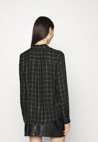 ONLY - ONLANNALIE - Button-down blouse - black/white - 2