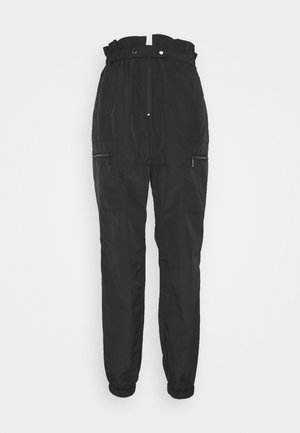 LIGHT AUTUMN - Trousers - black