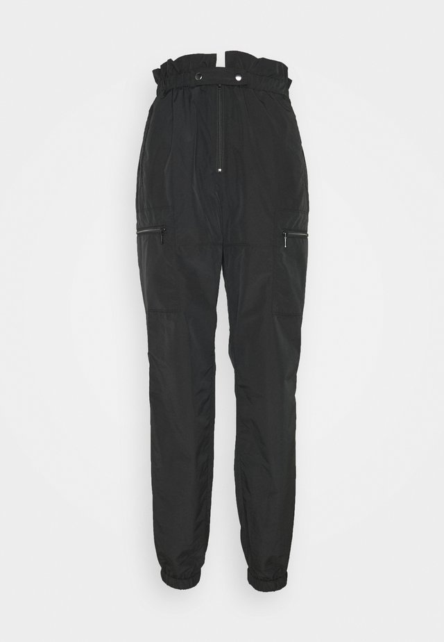 LIGHT AUTUMN - Pantalones - black