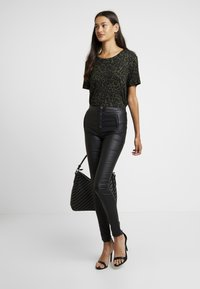 ONLY - ONLROYAL COATED BUTTON PANT - Spodnie materiałowe - black - 2