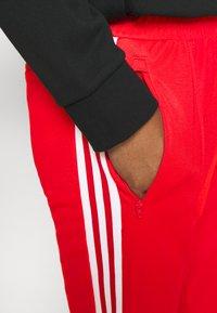 adidas Originals - BECKENBAUER UNISEX - Tracksuit bottoms - red - 3