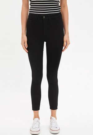 Vaqueros pitillo - black