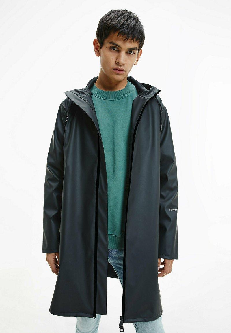Calvin Klein Jeans - TECHNICAL RAINCOAT - Parka - ck black